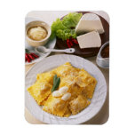 high angle view of stuffed ravioli served with rectangular photo magnet