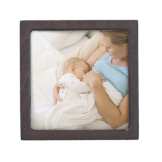 High angle view of woman breastfeeding baby gift box