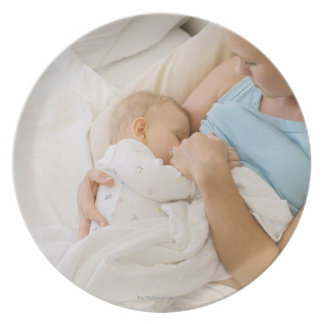 High angle view of woman breastfeeding baby melamine plate
