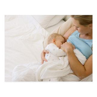 High angle view of woman breastfeeding baby postcard