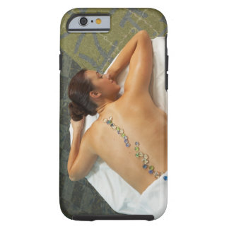 High angle view of woman receiving hot stone tough iPhone 6 case