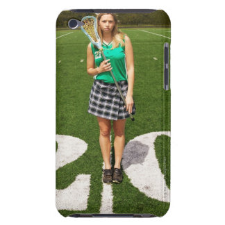 High school lacrosse player (16-18) holding barely there iPod cases