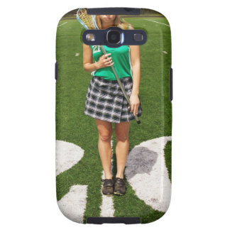 High school lacrosse player (16-18) holding galaxy SIII covers