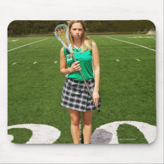 High school lacrosse player (16-18) holding mouse pad