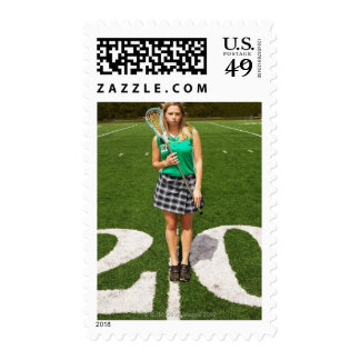 High school lacrosse player (16-18) holding postage stamp