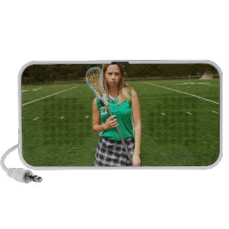 High school lacrosse player (16-18) holding notebook speakers