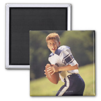 High school quarterback with football 2 inch square magnet