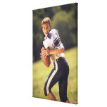 High school quarterback with football canvas print