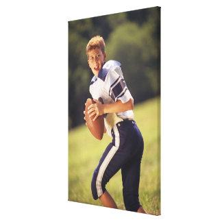 High school quarterback with football canvas print
