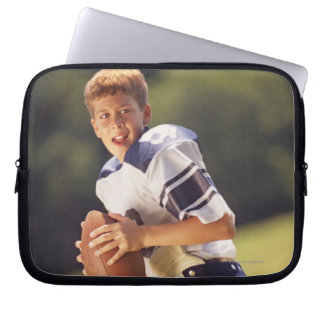 High school quarterback with football computer sleeve