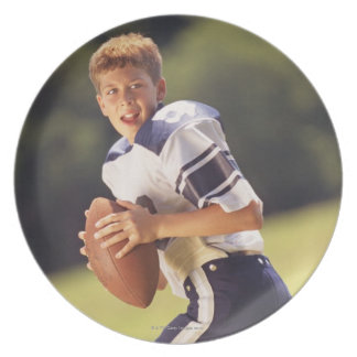 High school quarterback with football dinner plate