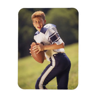 High school quarterback with football rectangular photo magnet