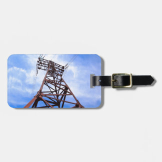 High-voltage tower on blue sky luggage tag