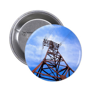 High-voltage tower on blue sky pinback button