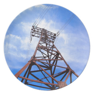 High-voltage tower on blue sky plate