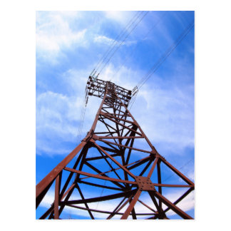 High-voltage tower on blue sky postcard