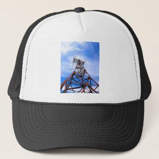 High-voltage tower on blue sky trucker hat
