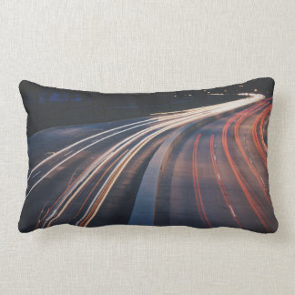 Highway at night in super speed throw pillows