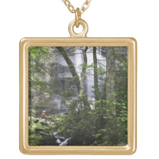 Hiker admires Falls Branch Falls Gold Plated Necklace