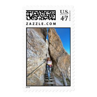 hiker on via ferrata postage stamp
