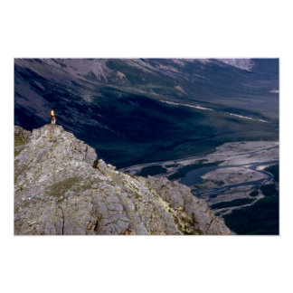 Hiker overlooking the Mountain River, NWT, Canada Print
