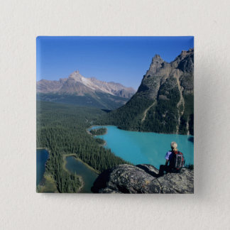 Hiker overlooking turquoise-colored Lake Button