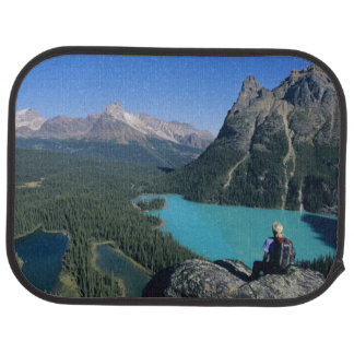 Hiker overlooking turquoise-colored Lake Car Mat