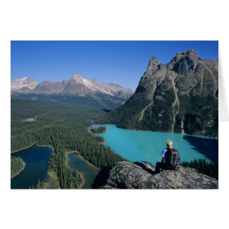 Hiker overlooking turquoise-colored Lake Card