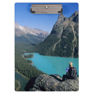 Hiker overlooking turquoise-colored Lake Clipboard