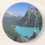 Hiker overlooking turquoise-colored Lake Beverage Coasters