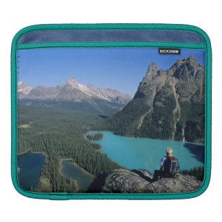 Hiker overlooking turquoise-colored Lake iPad Sleeve