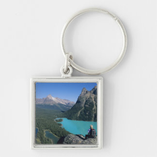 Hiker overlooking turquoise-colored Lake Keychain