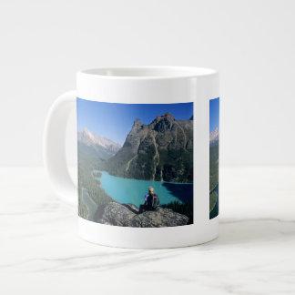 Hiker overlooking turquoise-colored Lake Large Coffee Mug