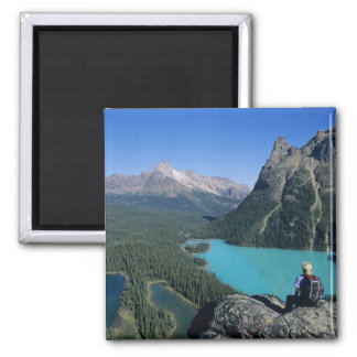 Hiker overlooking turquoise-colored Lake Magnet