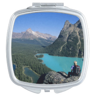 Hiker overlooking turquoise-colored Lake Makeup Mirror