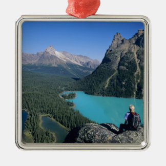 Hiker overlooking turquoise-colored Lake Metal Ornament