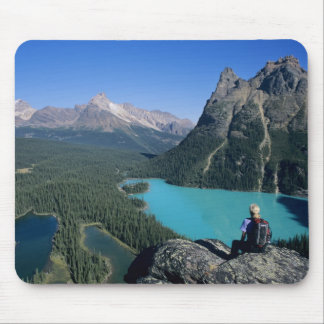 Hiker overlooking turquoise-colored Lake Mouse Pad