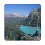 Hiker overlooking turquoise-colored Lake Puzzle Coaster