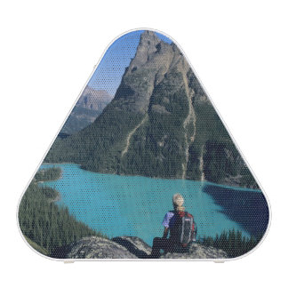 Hiker overlooking turquoise-colored Lake Speaker