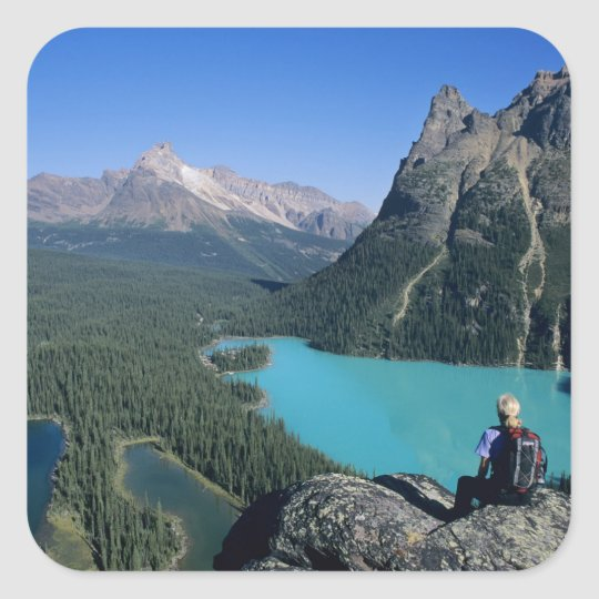 Hiker overlooking turquoise-colored Lake Square Sticker