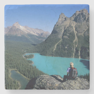 Hiker overlooking turquoise-colored Lake Stone Coaster