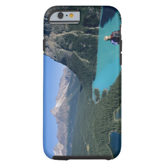 Hiker overlooking turquoise-colored Lake Tough iPhone 6 Case