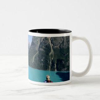 Hiker overlooking turquoise-colored Lake Two-Tone Coffee Mug