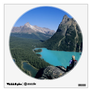 Hiker overlooking turquoise-colored Lake Wall Decal