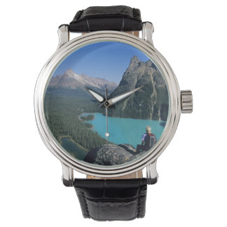 Hiker overlooking turquoise-colored Lake Wrist Watch