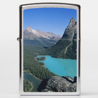 Hiker overlooking turquoise-colored Lake Zippo Lighter