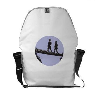 Hikers Crossing Single Log Bridge Oval Woodcut Courier Bag