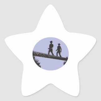 Hikers Crossing Single Log Bridge Oval Woodcut Star Sticker