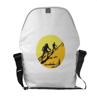 Hikers Hiking Up Steep Trail Circle Woodcut Messenger Bag