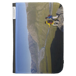 Hikers pausing to admire hill scenery case for kindle